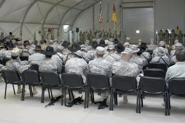 U.S. and Iraqi troops and civilian leaders watch the transfer-of-authority ceremony at COB Adder's Memorial Hall July 14. The 4th Brigade Combat Team, 1st Cavalry Division, transferred authority from the 1st BCT, 82nd Airborne Division.
