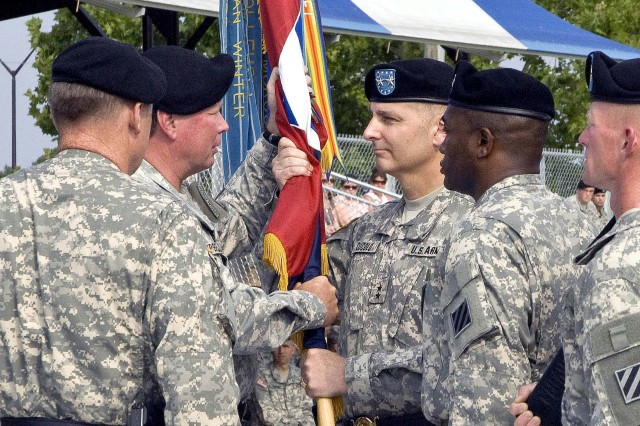 FORSCOM Commander Gen. Charles Campbell passes the 3rd Infantry Division colors to Maj. Gen. Tony Cucolo as Cucolo assumes command of the Marne Division at a ceremony held at Fort Stewart's Cottrell Field, July 14. Cucolo is the former U.S. Army Chief of Public Affairs.