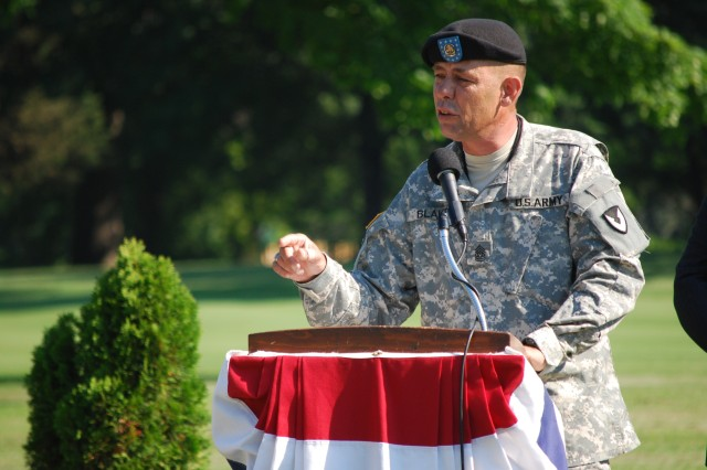 Army Sustainment Command's Command Sgt. Maj. Stephen D. Blake speaks at the Living Memorial dedication at Rock Island Arsenal.  The memorial honors the memory of Servicemembers Defense Civilians and Contractor Employees from Illinois and Iowa who have lost their lives as a result of combat operations in Southwest Asia.