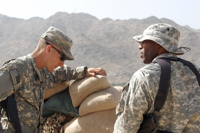 1st Lt. Robbie Murray takes advice from outgoing Team Dragon platoon leader, 1st. Lt. Anthony Williams at Firebase Baylough, June 30, 2008. Teams Dragon and Charlie engaged the enemy just two hours later, when anti-coalition forces carried out a complex attack against the base.