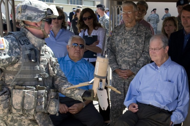 """House Armed Services Committee Chairman Ike Skelton (D-MO) and fellow committee member Syvestre Reyes (D-TX)are given a briefing about the advantages of the Urban Unmanned Ground Sensors by 1st LT Anderson with the Army Evaluation Task Force at Ft Bliss, TX, on July 12, 2008.  The Congressmen were briefed on the Army's plans to accelerate Future Combat Systems technologies to Soldiers in combat. Army photo by D. Myles Cullen"""""""