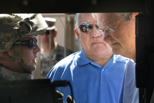 """House Armed Services Committee Chairman Ike Skelton (D-MO) and fellow committee member Syvestre Reyes (D-TX) listen to 1st LT Anderson with the Army Evaluation Task Force brief the additional capabilities provided with the Joint Tactical Radio System at Ft Bliss, TX, on July 12, 2008.  The Congressmen were briefed on the Army's plans to accelerate Future Combat Systems technologies to Soldiers in combat. Army photo by D. Myles Cullen"""""""