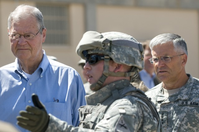 """House Armed Services Committee Chairman Ike Skelton (D-MO) and Chief of Staff of the Army, GEN. George W. Casey, Jr., listen to 1st LT Anderson with the Army Evaluation Task Force talk about the advantages of the Future Combat System called Integrated Computer System at Ft Bliss, TX, on July 12, 2008.  The Congressmen were briefed on the Army's plans to accelerate Future Combat Systems technologies to Soldiers in combat. Army photo by D. Myles Cullen """""""