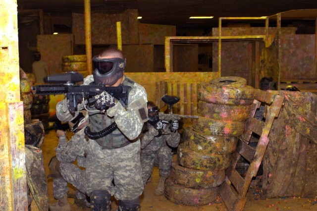 """Members of the """"Lethal Threat' Paintball Team perform a squad based movement in attempt to corner their enemy. By engaging the enemy, and placing covering fire in the enemy's direction, one member can then move to a closer position to lay down cover fire for the others to continue the move toward the objective."""