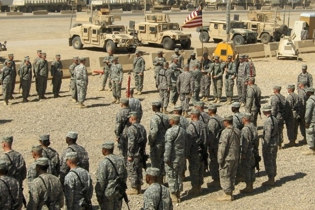 CAMP LIBERTY, Iraq - Soldiers stand in formation July 3 as Lt. Col. Damien Waddell of the 769th Engineer Battalion transfers authority over to Lt. Col. Matthew Zajac of the 46th Engineer Combat Battalion (Heavy) on Camp Liberty, Iraq. This ceremony signifies the handover of tactical construction projects in Baghdad to the 46th ECB (H). The 46th Eng. Bn. is assigned to the 926th Engineer Brigade serving with Multi-National Division Baghdad. (U.S. Army photo by Capt. Patrick Jenkins, HSC, 46th Eng. Combat Bn. (H), 926th Eng. Bde., MND-B)