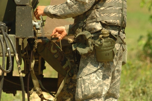 PFC Jarred Palmer from Fort Benning, Ga., takes a water break during the Installation Management Command's Soldier and Noncommissioned Officer of the Year competition held July 14-17 at Fort AP Hill, Va.