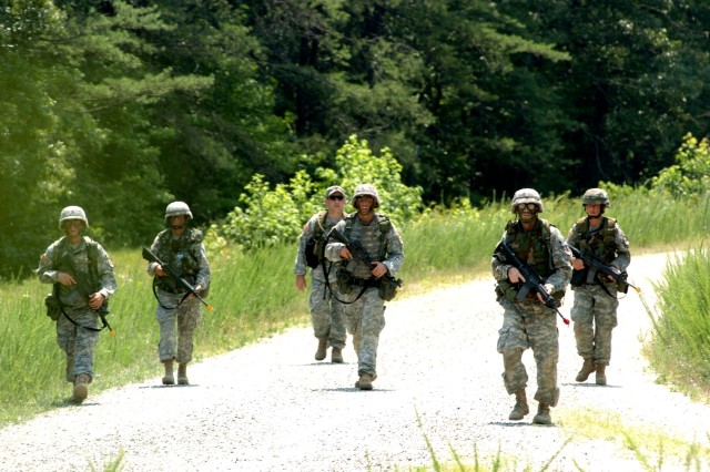 Soldiers patrol during the Soldier and NCO of the Year competition July 16 at Fort AP Hill, Va.