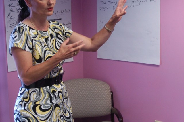 Deborah J. Joyce, Fort McPherson's Installation Safety Director, briefs the Lean Six Sigma process. The LSS project she led was responsible for improvements to the post in-processing procedures.