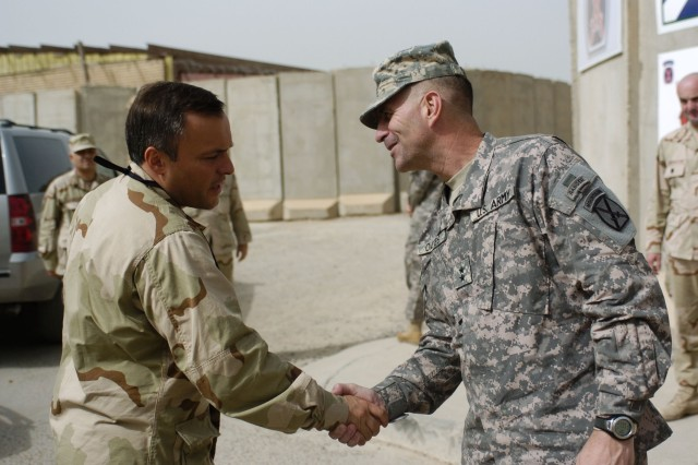 Major General Michael Oates, commander of Multi-National Division - Center and the 10th Mountain Division, greets Honorable Batu Kutelia, Georgian first deputy ministry of defence, during Kutelia's visit to Camp Victory July 17.