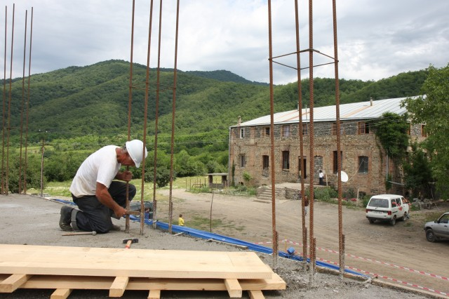A construction worker smooths rebar on the second story of a new, $137,000 child-care center for orphaned, disadvantaged, and handicapped children near the town of Gremi.