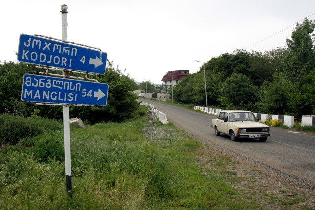 A road sign in Georgian and Roman scripts points the way toward the villages of Kodjori and Manglisi, both of which have humanitarian assistance projects that will support a vulnerable youth population.