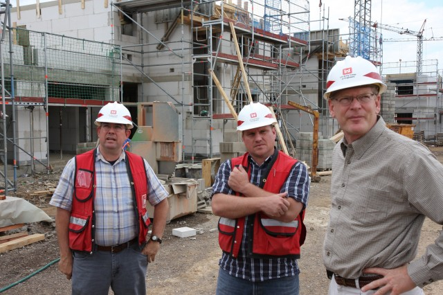 From left, project engineers Lou Reagan and Shaun Frost show Europe DistrictAca,!a,,cs Ramstein regional program manager Scott Deetz the housing projects on Spangdahlem Air Base.