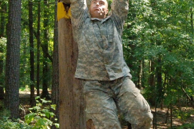 Sgt. 1st Class Brian Eisch negotiates a cross bar obstacle during the July 15 Fort Eustis, Va., Confidence Course event that was part of the 2008 U.S. Army Training and Doctrine Command NCO and Soldier of the Year Competition. A total of five Soldiers from across the nation competed for the top TRADOC title. Sgt. 1st Class Eisch, the NCO of the Year winner, represented the Reserve Officer Training Corps program at the University of Wisconsin, and U.S. Army Accession Command.