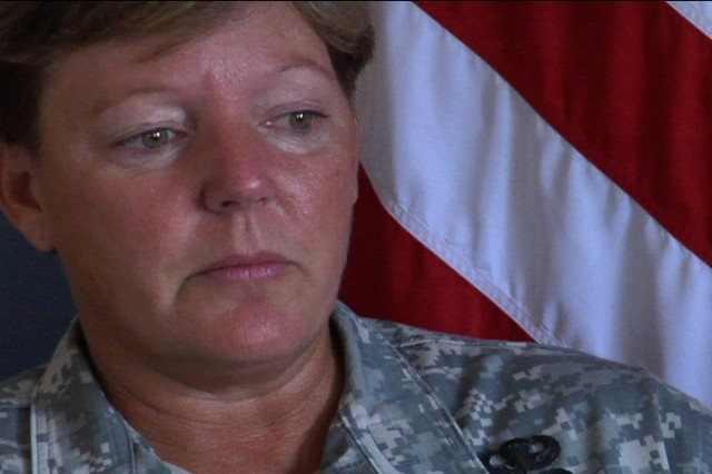 COL Heidi Brown reminisces after receiving the Legion of Merit award during her departure ceremony from Fort Bliss.