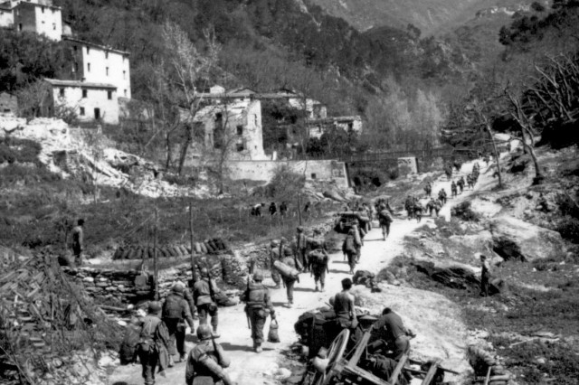U.S. Soldiers of the All-black 92nd Infantry  Division pursue retreating Germans through the Po Valley circa May 1945. The Soldiers, including Sgt. Alden Small, earned some 12,000 decorations and citations during World War II, including two Medals of Honor.