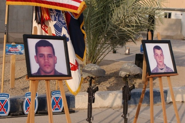 A memorial to Staff Sgt. Alex Jimenez and Spc. Byron Fouty stands outside the Multi-National Division - Center headquarters at Camp Victory during a memorial ceremony July 21.