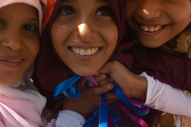 A group of girls smile in celebration of the Najaf International Airport inauguration July 20.