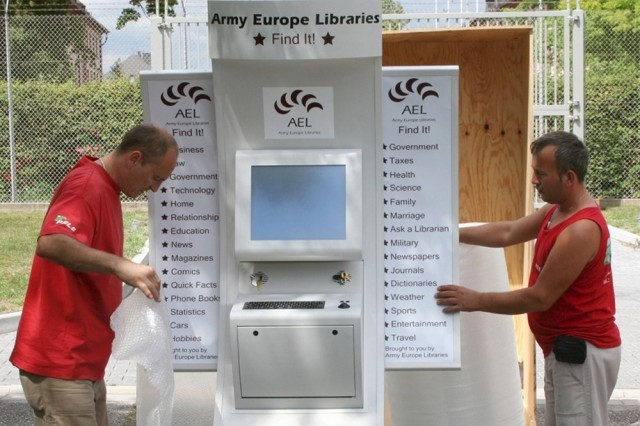 Movers crate an Army Europe Libraries e-Branch kiosk for shipment to Camp Victory, Iraq. The e-Branch kiosks are designed to support educational opportunities for Soldiers and deliver electronic library services and information to customers who can't get to a brick-and-mortar library