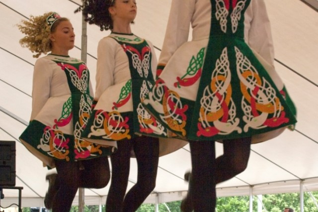 Members of the Davis Academy of Irish Dance leap before the Picatinny crowd.