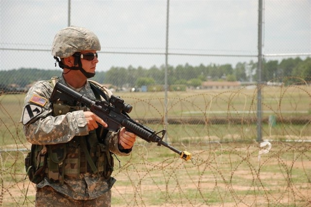 Spc. Frankie J. Smith of Blanchard, La., pulls security at a simulated holding point as part of Operation Lily Pad.  A Troop, 2nd Battalion, 108th Cavalry ran the exercise to test the capabilities and needs of a personnel collection point in the event of a hurricane.