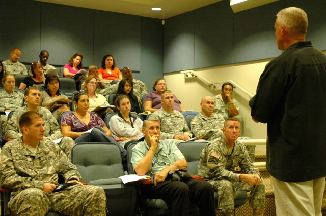 SCHOFIELD BARRACKS, Hawaii - Mike Webb, chief of Program and Policies, G-1, U.S. Army-Pacific, speaks to Schofield Barracks' family readiness support assistants and military leaders during a town hall meeting at Kalakaua Community Center, here, July 14.