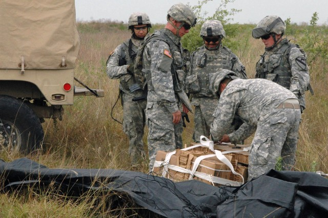 Soldiers of Co. D, 3-8 Cav., 3rd BCT, 1st Cav. Div.,  collect supplies provided by air on Fort Hood, July 16. This maneuver is part of a two week training exercise designed to prepare the Brigade for their upcoming deployment to Iraq.