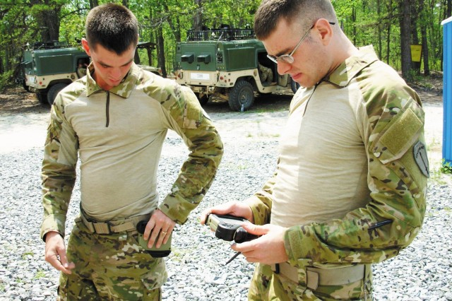 Two Soldiers from the Natick Soldier Research, Development and Engineering Center test the new ruggedized PDA with the new flexible display screen.