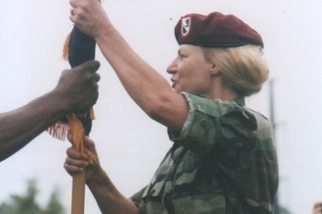 Brig. Gen. Ann Dunwoody passes the guidon of the 1st Corps Support Command change of command at Fort  Bragg, N.C.