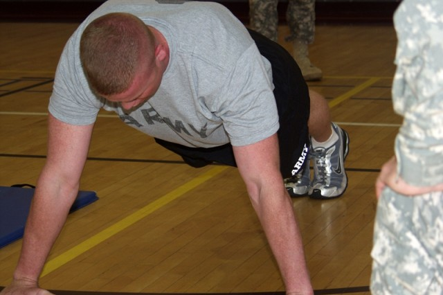 Staff Sgt. Christopher Barber performs a push up during the Army Physical Fitness portion of the competition.
