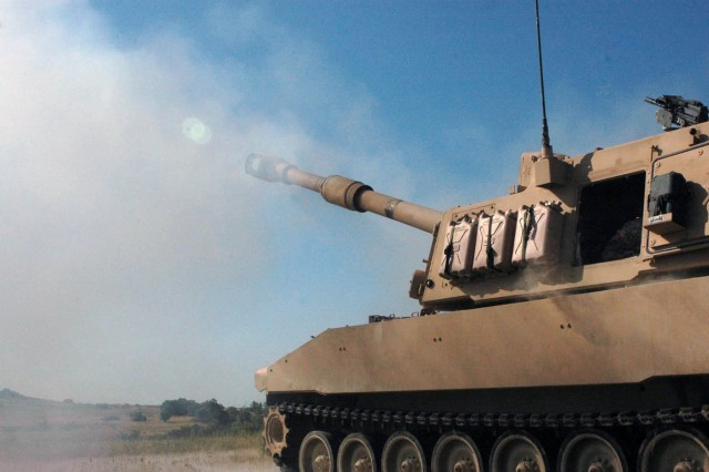 "A M109A6 155mm Paladin system recoils shortly after a live fire mission on Fort Hood, Texas. Battery A, 2nd Battalion, 82nd Field Artillery Regiment, 3rd Brigade Combat Team, 1st Cavalry Division provides indirect fire support for combat patrols as part of a two-week training exercise designed to prepare ""Greywolf"" troops for an upcoming deployment to Iraq."