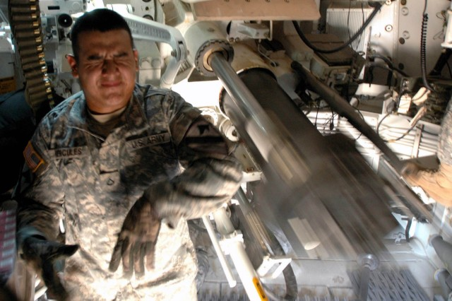 "Pfc. Jose Hercules, a gunner with Battery A, 2nd Battalion, 82nd Field Artillery Regiment, 3rd Brigade Combat Team, 1st Cavalry Division from Miami, Fla., reacts to pulling the firing mechanism of an M109A6 155mm Paladin system July 16. 3rd BCT is holding a two week training exercise on Fort Hood, Texas designed to prepare ""Greywolf"" Soldiers for their upcoming deployment to Iraq."
