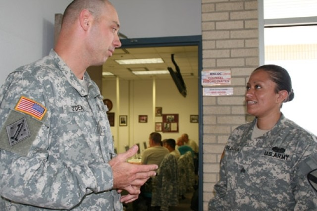 Sgt. 1st Class Thomas O'Dea, senior small group leader for the academy's Basic NCO Course, speaks with student Sgt. Rosangela Villarreal prior to class Friday. Villarreal is among the first group of Warriors in Transition to attend the Army Medical Department NCO Academy.