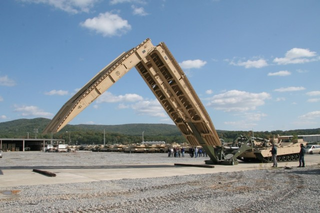 The Joint Assault Bridge is halfway extended for its onlookers at the 2006 prototype demonstration held at the Anniston Army Depot, Ala.-test track.