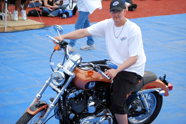 Pfc. Miguel Palazuelos, Camp Hovey, sits on his new 2008 Harley Davidson motorcycle, valued at $13,000, which he won at USAG-Humphrey's Independence Day celebrations, July 4, as part of Miller Brewing Company's 'Ride Free' promotion.