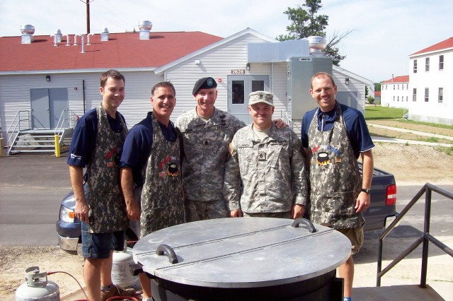 Standing around the jambalaya pot are from left chefs Scott Duplechein and Jody Elisar, Fort McCoy Garrison Command Sergeant Major Command Sgt. Maj. M. Kevin Dubois, Command Sgt. Maj. Chad Lynch and chef Jeff Parent.