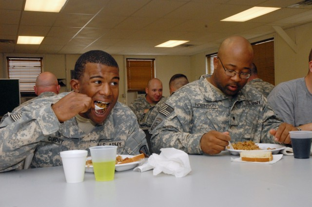 Sgt. Gregory Guidry (left) and Spc. Travis Robinson of the 769th Engineer Battalion enjoy a serving of jambalaya at Fort McCoy.