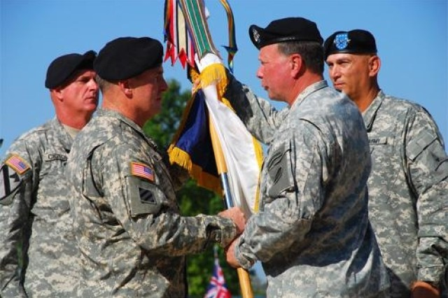 Gen. Charles Campbell, FORSCOM commanding general, passes the III Corps guidon to Lt. Gen. Rick Lynch during the III Corps change of command ceremony 9 a.m. Friday.