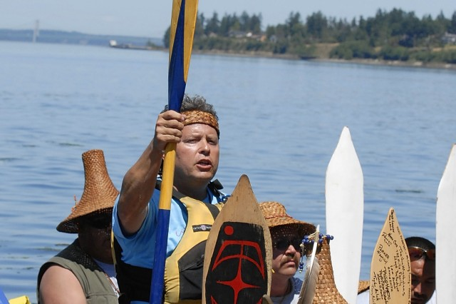 A member of the Cowlitz canoe family asks permission to come ashore during a ceremony July 15 at Solo Point on Fort Lewis.