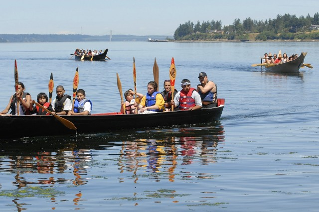 Canoe families from local tribes make their way to shore July 15 at Solo Point on Fort Lewis as part of their yearly tribal journeys which will end in British Columbia.