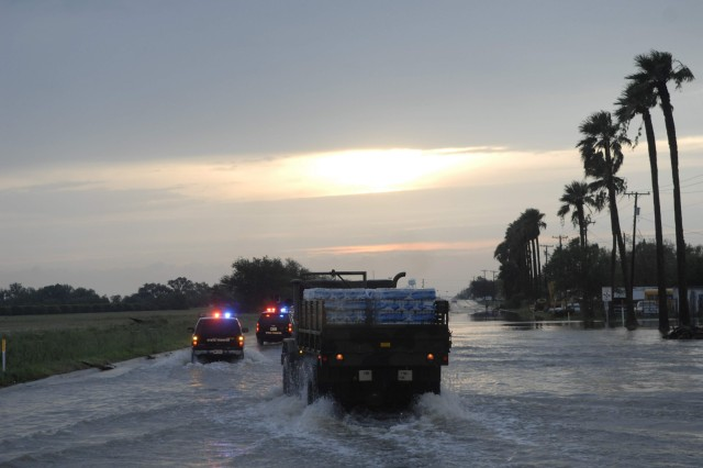 A convoy of relief supplies make their way to the flood ravaged area of the southernmost tip of the Texas Gulf Coast following landfall of Hurricane Dolly.
