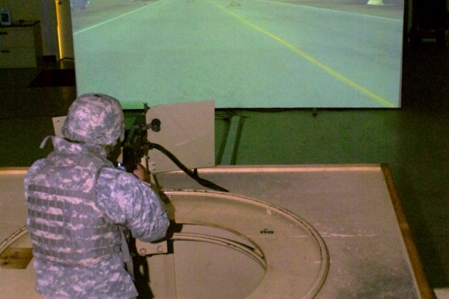 Spc. Robert Quates, orderly clerk for A Co., DSTB, 1st Cav. Div., takes aim with a turret mounted 240B Squad Fire Weapon during a simulated convoy at the Warrior Skill Trainer on Fort Hood Texas, July 17.