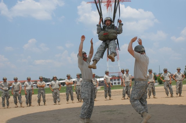 At Fort Benning, Ga., Pfc. Amanda Cox of B Company, 1st Battalion (Airborne), 507th Parachute Infantry Regiment, screams as Sgt. Nicholas Johnson and Pvt. Jacob Tatum let go of her and she is pulled up the 250 feet tower at Eubanks Field. Before taking the plunge from the tower in their second week of training, all Airborne Soldiers learn how to fall, how to handle twisted lines and how to slip away from other jumpers. After the tower, Soldiers jump five times from a plane at 1,250 feet.  Soldiers graduate after three weeks of training.