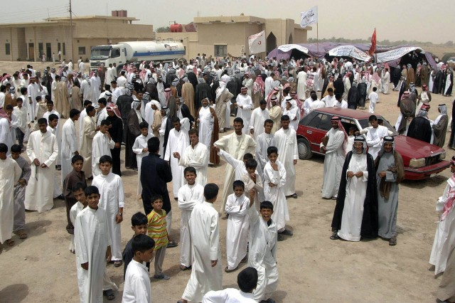 More than 500 sheikhs mingle outside a tent during an annual meeting to discuss issues concerning their tribes and upcoming elections in Samawa July 16. The sheikhs from the southern provinces also met with leaders from the 2nd Sqdn., 12th Cav. Regt.,4th  BCT, 1st Cav. Div.