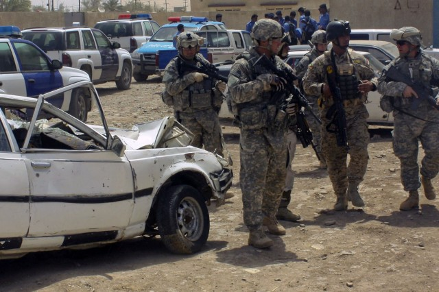 American troops from the 2nd Sqdn., 7th Cav. Regt., , 4th BCT, 1st Cav. Div. patrol with an Iraqi Soldier in Amarah. The two countries' troops are working together to secure the southern region of Iraq from criminals and smugglers.