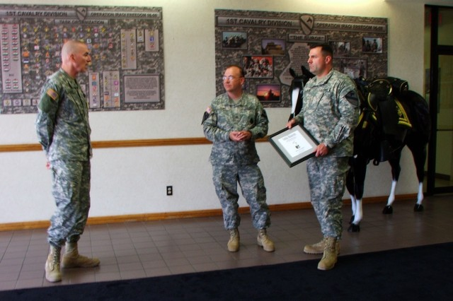 """Maj. Gen Daniel Bolger (far left) talks with Cookeville, Tenn. native, Staff Sgt. Jon Cupp and Dale City, Va., native Maj. Randall Baucom after presenting them with the Telly Award for excellence in broadcasting. Baucom is the 1st Brigade Combat Team, 1st Cav. Div. officer in charge of Public Affairs and Cupp was the noncommissioned officer in charge of the """"Ironhorse"""" public affairs office during Operation Iraqi Freedom 06-08, when the live broadcast from Camp Taji, Iraq linked Soldiers to motorcycle enthusiast in Sturgis, S.D."""