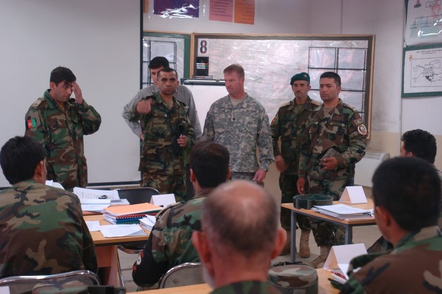 Sgt Major of the Afghanistan army Safi Roshan introduces Sgt. Maj. of the Army Kenneth O. Preston at the Kabul Military Training Compound. Preston visited the ANA NCO Academy classroom, Battle Staff Course, barracks complex and had the opportunity to speak to two NCO classes.