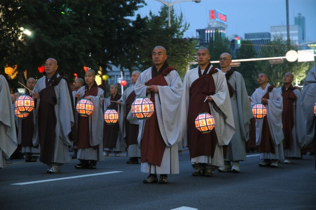 Buddhist monks march through downtown Seoul during a celebration for Buddha's birthday.
