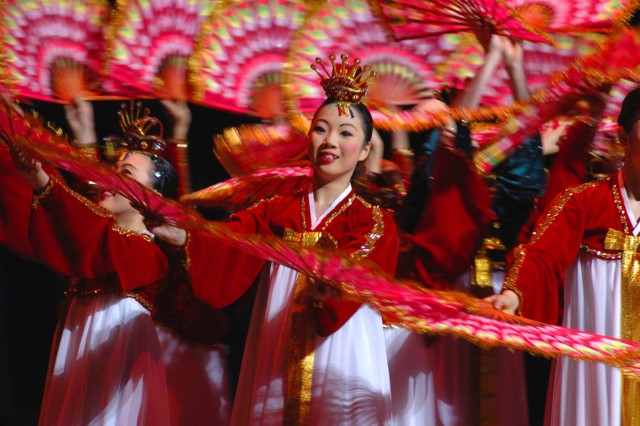 Members of the Little Angels Dancers perform a traditional Korean folk dance. Established in 1962 to introduce Korean culture to the world through song and dance, the Little Angels have a performing arts center in Seoul.