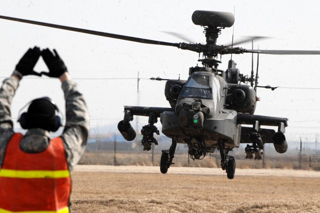 An AH-64 Apache helicopter from Camp Humphreys arrives at Kunsan Air Base as part of the Key Resolve/Foal Eagle exercise.