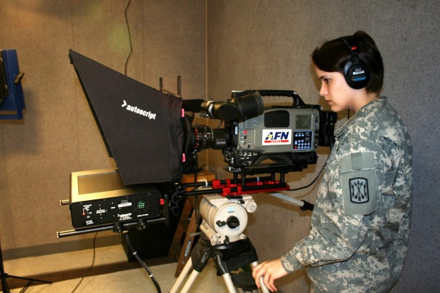 TV production specialist, Spc. Heather Krause, shoots the newscast from the network's contingency studio at AFN-Daegu.